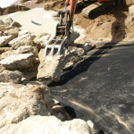 Placing Armour Rock on Geotextile